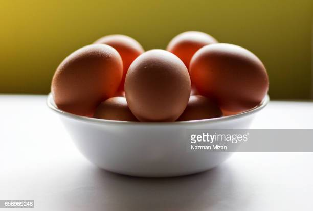 Eggs in a bowl, fresh from farm. A food concept.