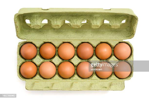 eggs in a carton on white background - dozen stock pictures, royalty-free photos & images