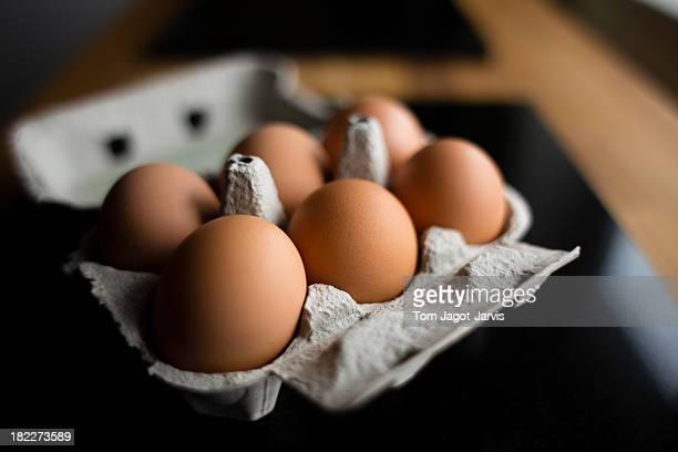 Eggs in an egg carton on a table