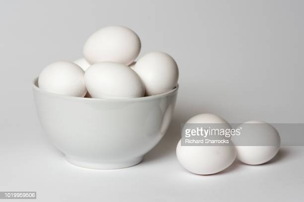 eggs in bowl - animal egg stock pictures, royalty-free photos & images