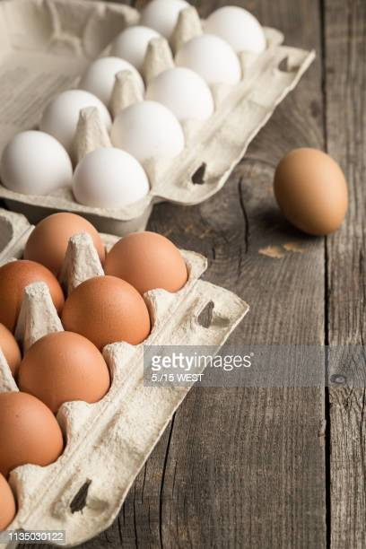 eggs in box container on a wooden table - animal egg stock pictures, royalty-free photos & images
