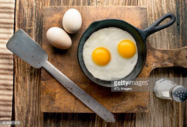 eggs on barnwood - fried eggs stock pictures, royalty-free photos & images