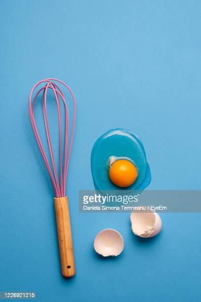 eggs on blue background - wire whisk stock pictures, royalty-free photos & images