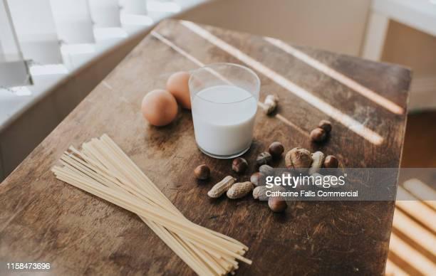 eggs, pasta, nuts and milk - 偏見 ストックフォトと画像
