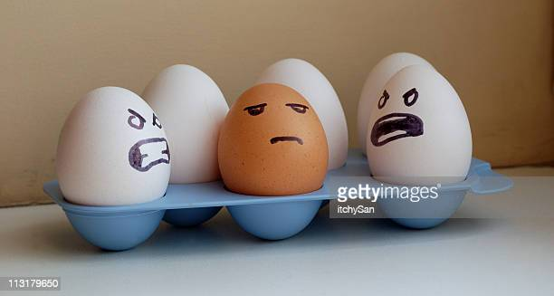 eggs racism - prejudice stock photos and pictures