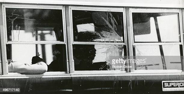 Eggs splatter across a school bus window as the bus leaves South Boston High School in Boston on Sept 13 the second day of school under the new...