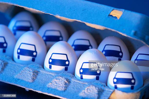 Eggs with pictures of car in an egg carton