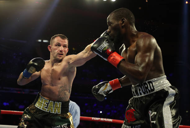 Egidijus Kavaliauskas punches Terence Crawford during their bout for Crawford's WBO welterweight title at Madison Square Garden on December 14, 2019...