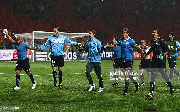 Egidio Arevalo Andres Scotti Diego Lugano and Fernando Muslera of Uruguay celebrate after the 2010 FIFA World Cup South Africa Round of Sixteen match...