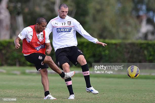 Egidio Arevalo Rios and Luigi Giorgi in action during a Palermo training session at Tenente Carmelo Onorato Sports Center on November 2 2012 in...