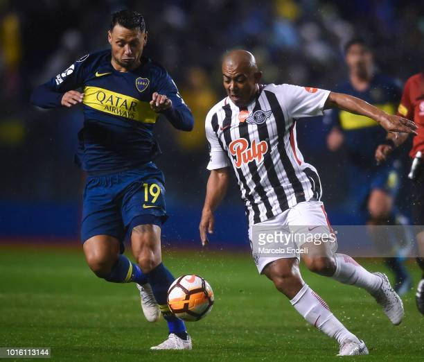 Egidio Arevalo Rios of Libertad fights for the ball with Mauro Zarate of Boca Juniors during a round of sixteen first leg match between Boca Juniors...