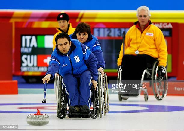Egidio Marchese of Italy releases the stone during Wheelchair Curling match between Italy and Switzerland on day three of the Turin 2006 Winter...