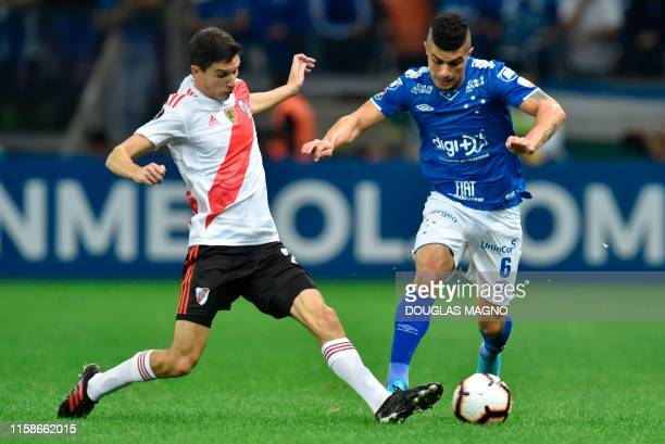 Egidio of Brazil's Cruzeiro is marked by Gonzalo Montiel of Argentina's River Plate during their Copa Libertadores football match at Mineirao Stadium...