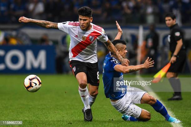 Egidio of Cruzeiro struggles for the ball with Jorge Carrascal of River Plate during a match between Cruzeiro and River Plate as part of Copa...