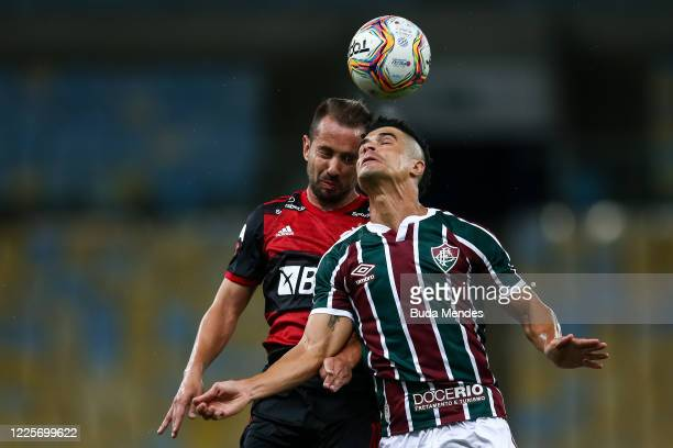 Egidio of Fluminense heads the ball against Everton Ribeiro of Flamengo during the match between Flamengo and Fluminense as part of the Taca Rio the...