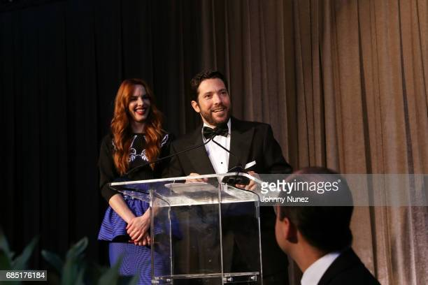 Eglantina Zingg and CoFounder of Glasswing Diego de Sola appear onstage during the Glasswing International 10th Anniversary Gala at Tribeca Rooftop...