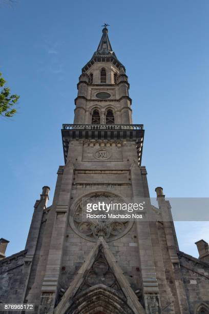 Eglise Saint Jacques bell tower in the daytime Old vintage architectural features of the temple