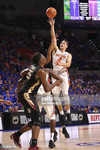 Egor Koulechov of the Florida Gators attempts a shot over Mfiondu Kabengele of the Florida State Seminoles during a NCAA basketball game at the...