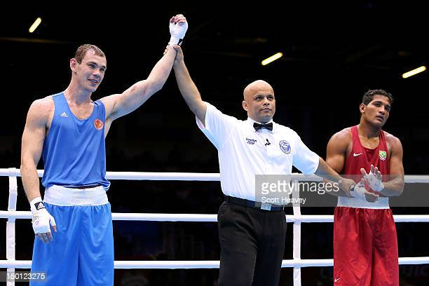 Egor Mekhontcev of Russia reacts as he was declared the winner against Yamaguchi Falcao Florentino of Brazil during their Men's Light Heavy Boxing...