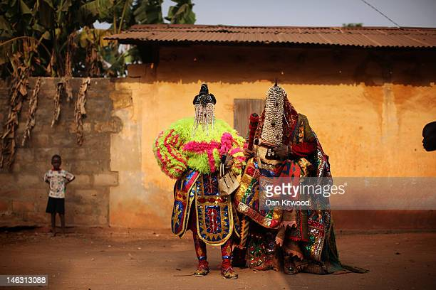 'Egungun' spirits stand during a Voodoo ceremony on January 10 2012 in Ouidah Benin The Egungun are masqueraded dancers that represents the ancestral...