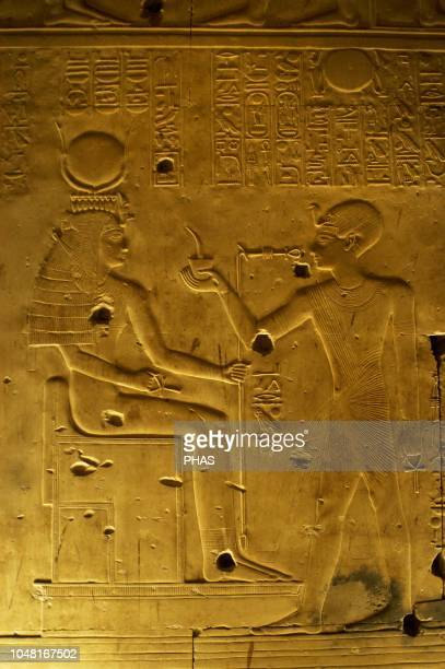 Egypt Abydos Temple of Seti I New Kingdom 19th Dynasty Relief with original polychrome The Pharaoh making offerings to goddess Isis 12921189 BC