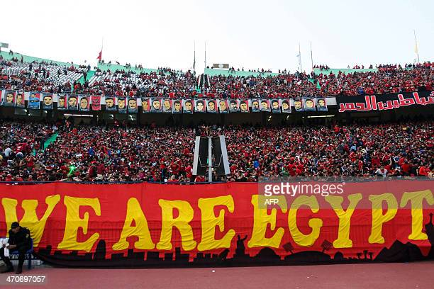 Egypt AlAhly fans chant slogans in support of their team ahead of their African Super cup final football match against Tunisia's Club Sportif Sfaxien...