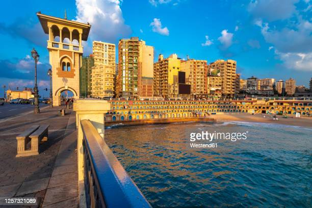 egypt, alexandria,stanley bridge and beach at sunset - alexandria stock pictures, royalty-free photos & images