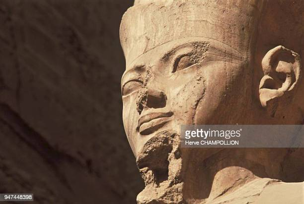 Egypt Amon Temple of AmonRê in Karnak East Thebes This limestone statue of the god Amon is placed in a large pillared room in the temple It is...
