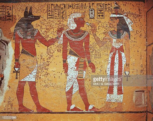 Egypt Ancient Thebes Luxor Valley of the Kings Tomb of Tutankhamen Burial chamber Detail of mural paintings In the presence of Anubis pharaoh...