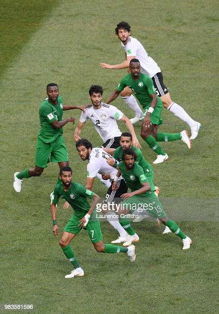 Egypt and Saudi Arabia players look to compete for the ball during the 2018 FIFA World Cup Russia group A match between Saudia Arabia and Egypt at...