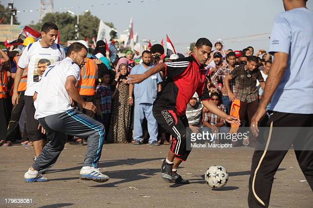 CONTENT] Egypt Cairo 9/8/2013 The two main Brotherhood sitins continue to block the Rabaa AlAdawiya cross point in Nasr City and AlNahda Square in...