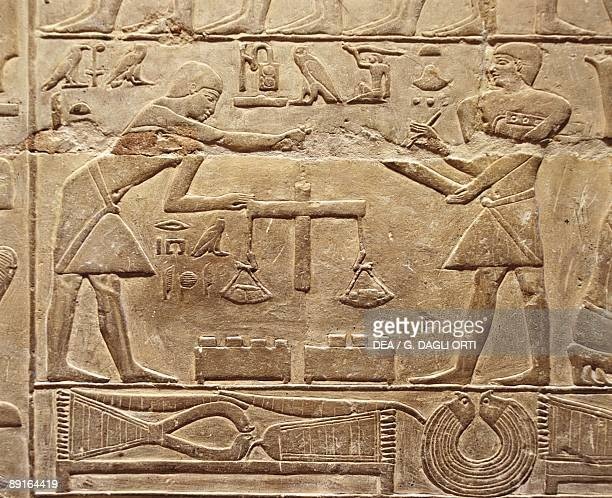 Egypt Cairo Ancient Memphis Saqqara Necropolis Private funerary mastaba of Mereruka 6th Dynasty 2349 BC Relief of goldsmiths weighing gold