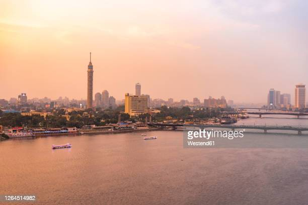 egypt, cairo, nile with the cairo tower on gezira island at sunset - egypt stock pictures, royalty-free photos & images