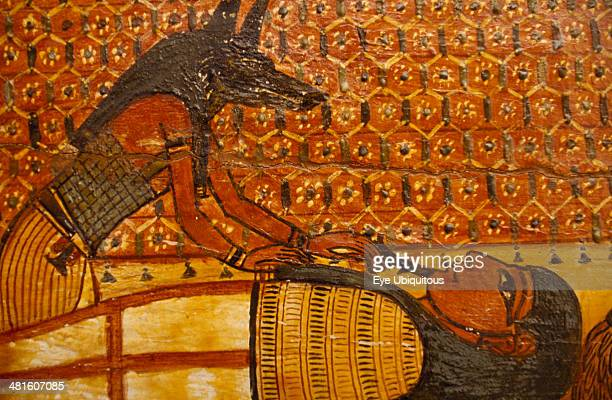 Egypt Cairo Painting on wooden coffin Jackal Headed God Anubisover reclining figure