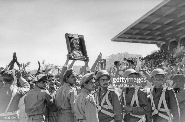Egypt celebrates its first anniversary since the revolution which deposed King Farouk 1953 Here a man holds up a picture of Egypt's first president...
