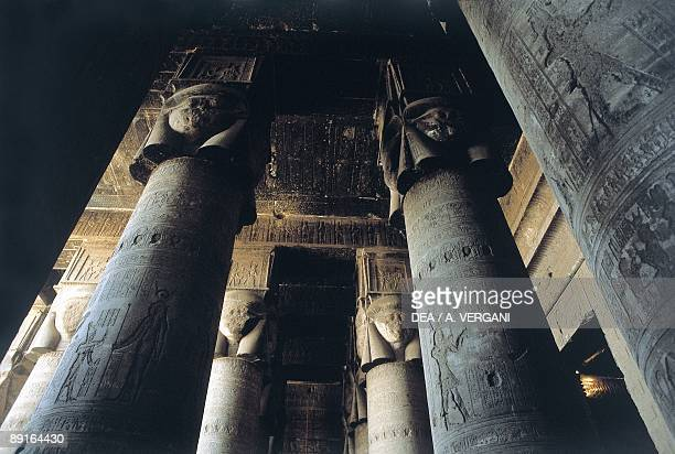 Egypt Dandarah Temple of Hathor columns at hypostyle hall low angle view