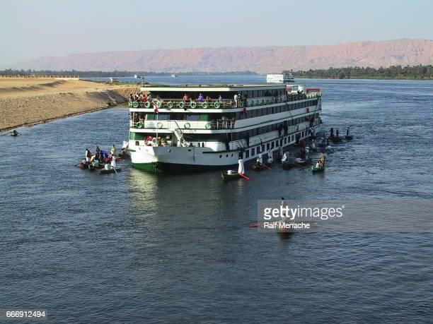 Egypt Esna. Nile Cruises surrounded by  floting market.