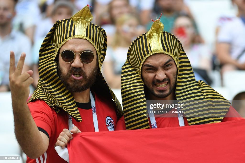 TOPSHOT - Egypt fans cheer on the team before the Russia 2018 World Cup Group A football match between Saudi Arabia and Egypt at the Volgograd Arena in Volgograd on June 25, 2018. (Photo by Philippe DESMAZES / AFP) / RESTRICTED