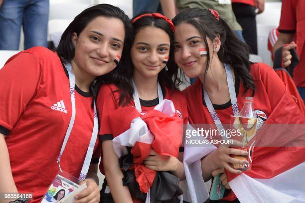 Egypt fans pose for a photo before the Russia 2018 World Cup Group A football match between Saudi Arabia and Egypt at the Volgograd Arena in...