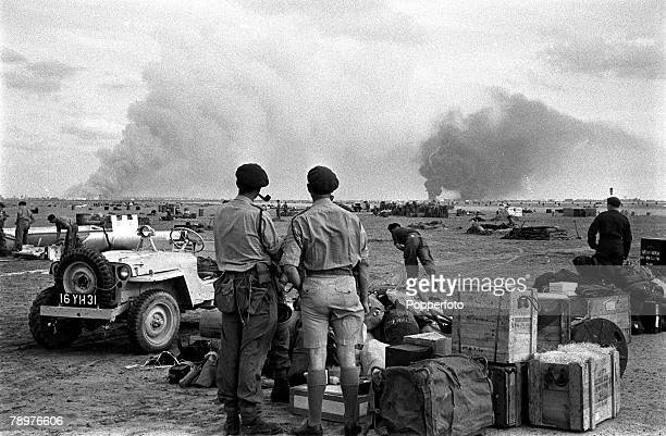 Egypt Invasion Gamal airport falls and as British Paratroopers fanned out pushing on to Port Said equipment and ammunition piled up on the dropping...