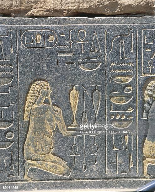 Egypt Karnak Red chapel of Hatshepsut golden relief wine offering