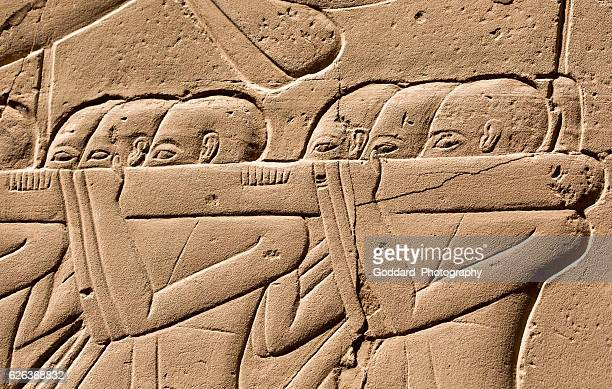 egypt: karnak temple complex - egyptian slaves stock pictures, royalty-free photos & images