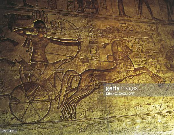 Egypt Lower Nubia Nubian monuments at Abu Simbel Great temple of Ramses II Reliefs detail showing Ramses II atop chariot at the battle of Qadesh