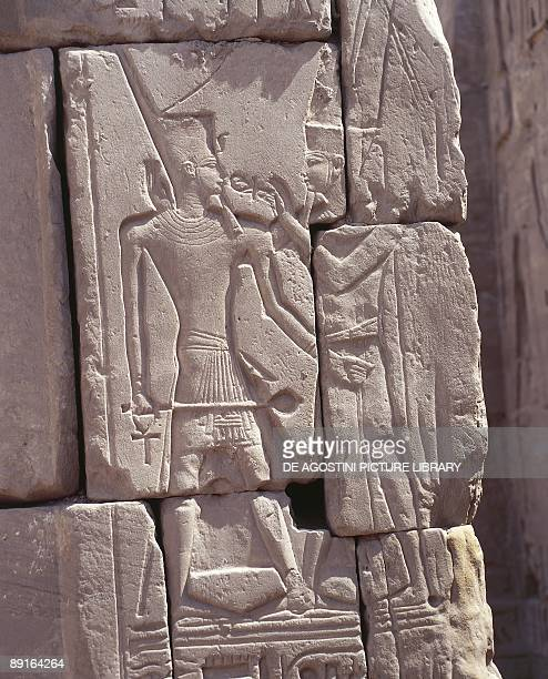 Egypt Luxor Karnak Great Temple of Amon relief of god Amon offering lifesymbol ankh to dead pharaoh