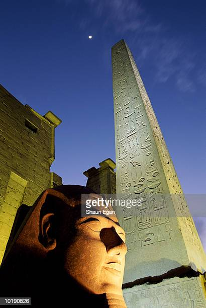 Egypt, Luxor, Luxor Temple, statue and obelisk at night, close-up