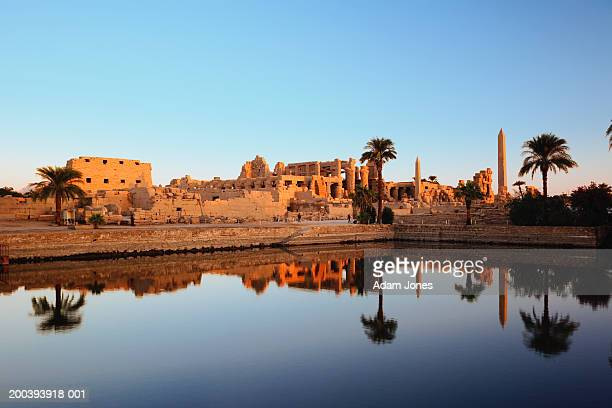egypt, luxor, nile river, karnak temple reflecting on sacred lake - ancient egyptian culture stock pictures, royalty-free photos & images