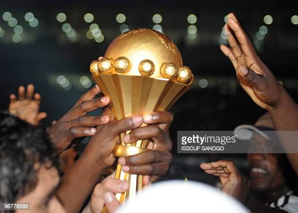 Egypt National football team players celebrates with the cup after their victory against Ghana on January 31 2010 at the November 11 stadium in...