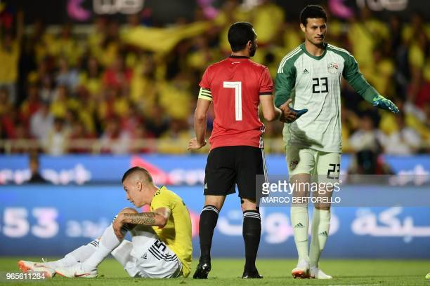 Egypt national team goalkeeper Mohamed El Shenawy reacts next to Egypt national team defender Ahmed Fathi during their international friendly...