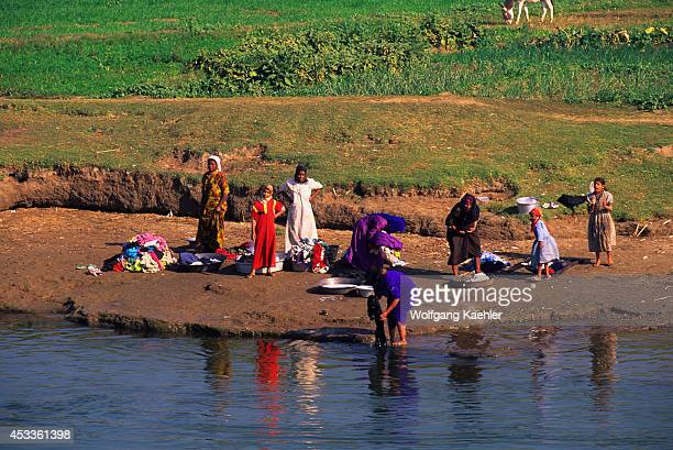 Egypt Nile River Between Luxor And Dendera People Doing Laundry