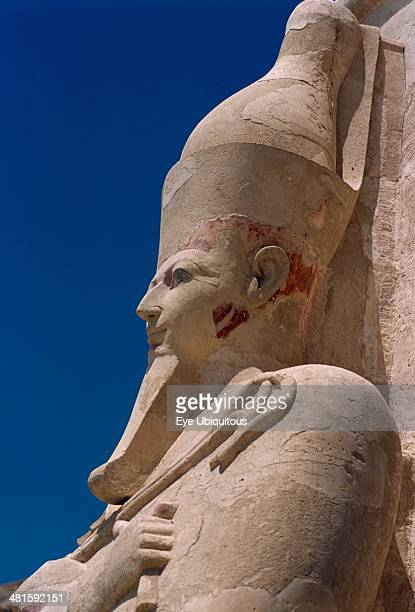 Egypt Nile Valley Thebes DeirelBari Hepshepsut Mortuary Temple Side profile of Osiride statue of Hepshepsut represented as a male with a beard and...
